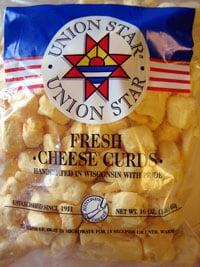 See through bag of chesses curds with the Union Star Cheese Factory emblem on the bag