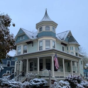 The Franklin Street Inn, a beautifuly Queen Anne Victorian home, covered by a light snowfall