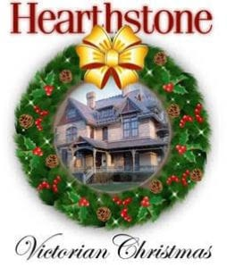 Hearthstone Victorian Christmas logo. Picture of Heathstone House inside a Christmas wreath with a gold bow at the top.
