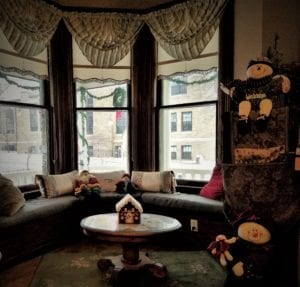 Franklin Street Inn Parlor and window seat with winter decorations