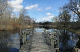 Wooden Footbridge over river at Gordon Bubolz Nature Preserve