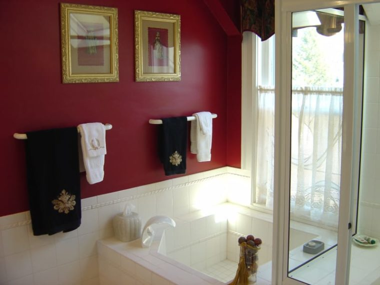 Bathroom in Lawrence Room with red walls and square tub