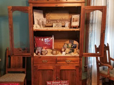 open cabinet in Gift Shop displaying items for sale