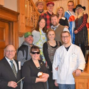 Costumed Murder Mystery guests pose for group photo on Franklin Street Inn Grand Staircase