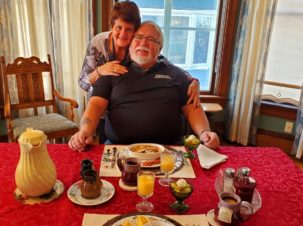 Guests Robin and Bob pose together before breakfast in the Franklin Street inn Dining Room