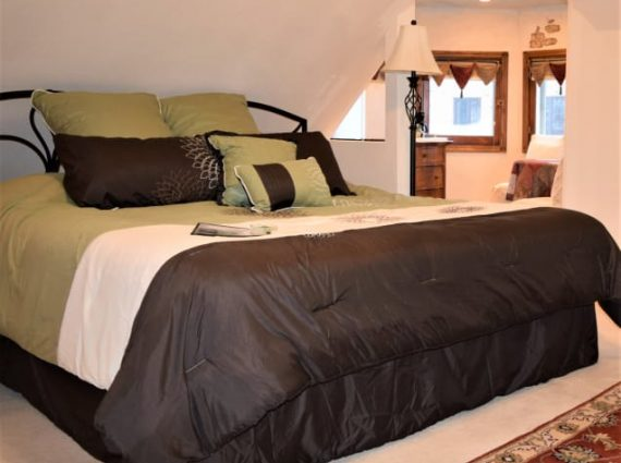 Turret Suite with green linens