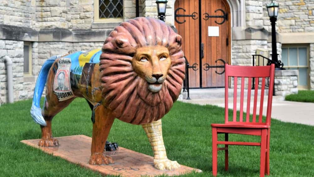 Red chair next to artistic lion