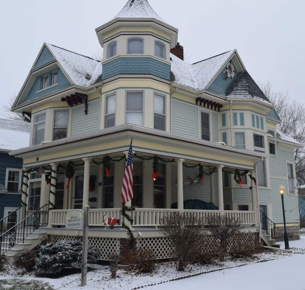 Front exterior view of Franklin Street Inn at Christmas with snow on the ground
