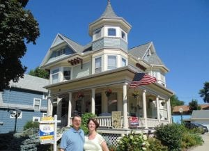 Innkeepers standing in front of Franklin Street Inn