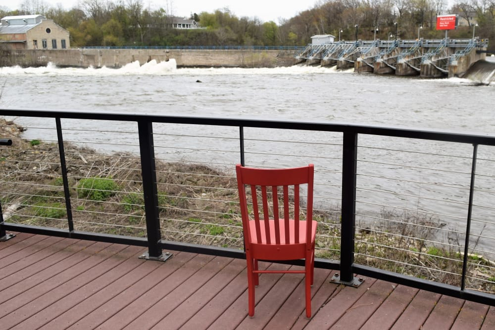 red chair lookout out over dam